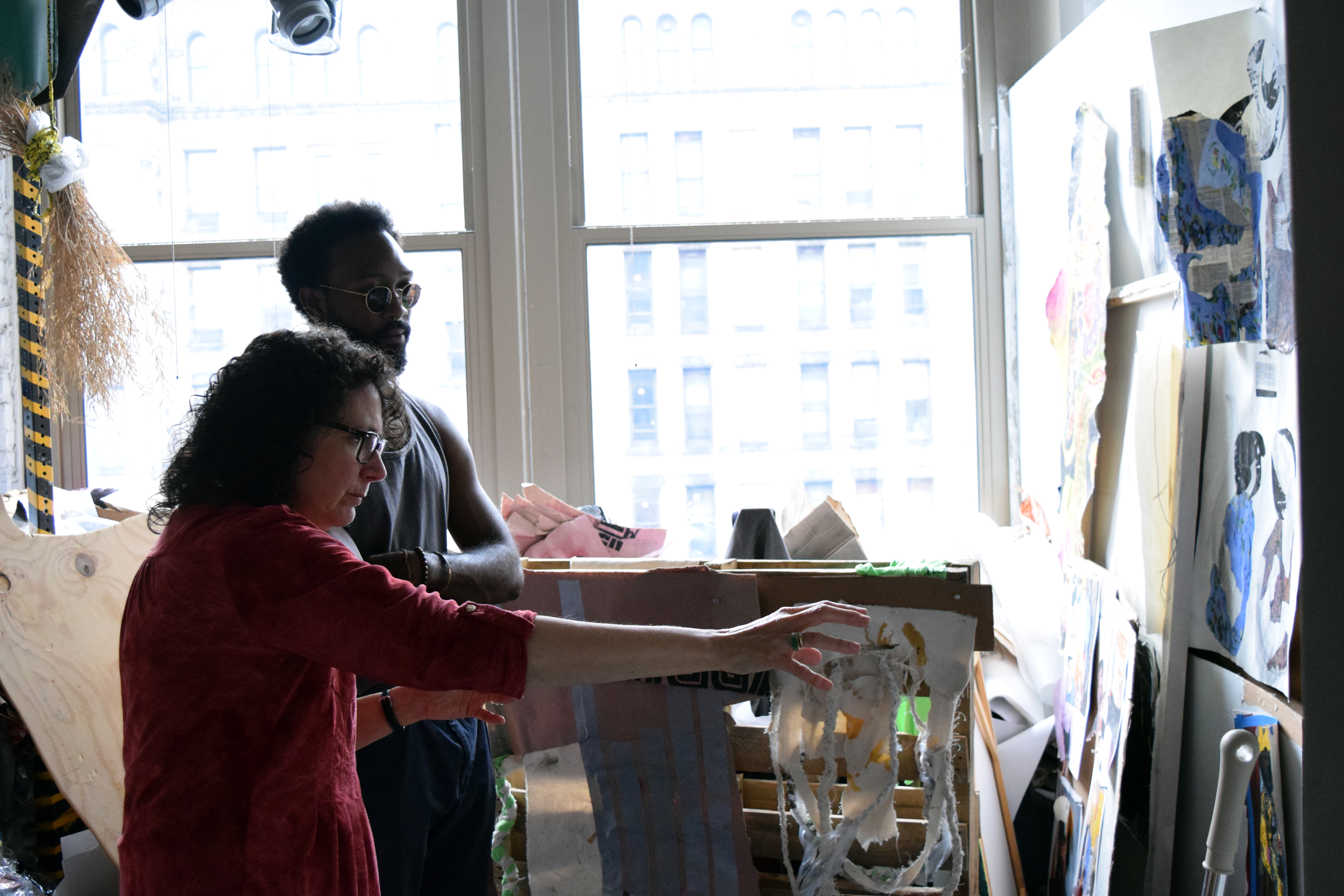 A graduate student in a critique with Drawing chair Renée Foulks