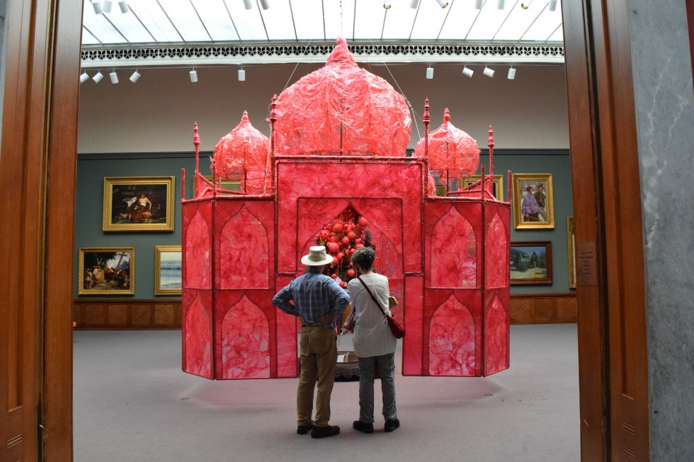 Museum visitors enjoy an early peek at Banerjee's installation.