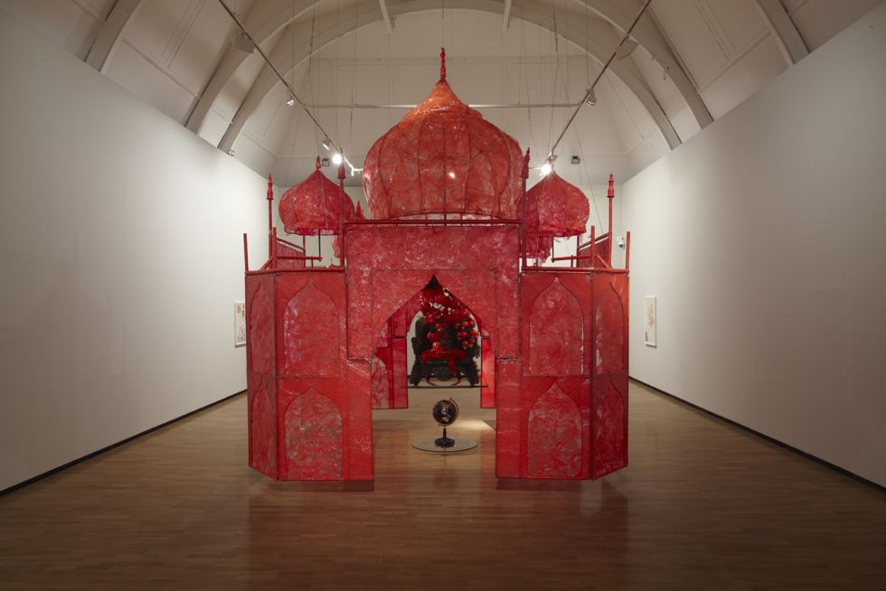 Rina Banerjee, Take me, take me, take me…to the Palace of love, 2003, plastic, wood chair, steel and copper framework, floral picks, foam balls, cowrie shells, quilting pins, moss, stone globe, glass, synthentic fabric, fake birds, 13 x 13 x 18 ft.