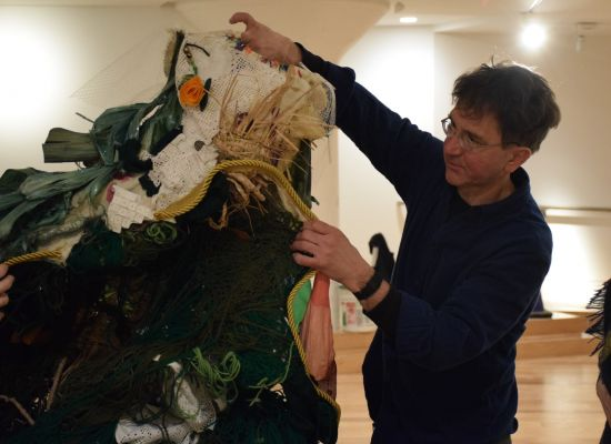 School of Fine Arts Exhibitions Coordinator, Brian Boutwell '04, assists with an installation.