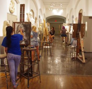 Students draw in cast hall