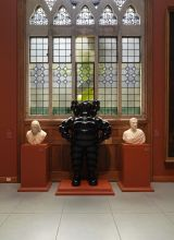 CHUM, 2009. Painted fiberglass, 90 x 54 x 30 in. Flanked by Horatio Greenough's Marquis de Layfayette, 1831 (right), and Giuseppe Iardella's Benjamin Franklin, ca. 1804 (right) in the Washington Foyer, Historic Landmark Building, Photo by Barbara Katus a