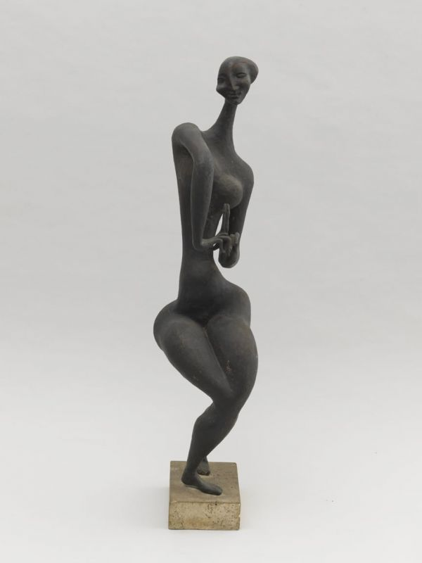 "John Rhoden, ""Dancer"" (n.d.). Bronze on stone base, 31 x 6 x 8 inches."