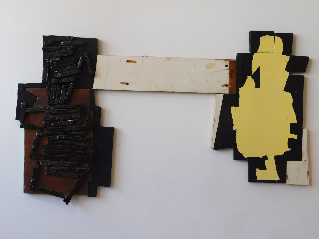 Kate Moran, ceramic 'logs', wood painted black, offwhite, yellow with an unpainted section the color of rust, woods screws its natural color of rust, wood screws, H 23'x W 40'x D 1', 2018