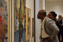 A visitor looks at a work during the ASE preview party.