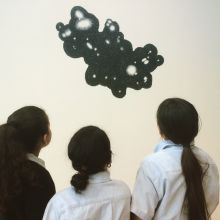 school-children  looking at an artwork