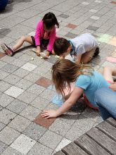 Campers drawing on PAFA's Lenfest Plaza with chalk