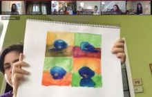 Camper proudly sharing their watercolor painting online