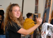 Student painting self-portrait