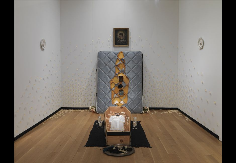 "Maurie Carroll, ""The Night My Ghost Fell Out"", 6' x 12', Installation of Mattress, Embedded Paintings, and Petals"