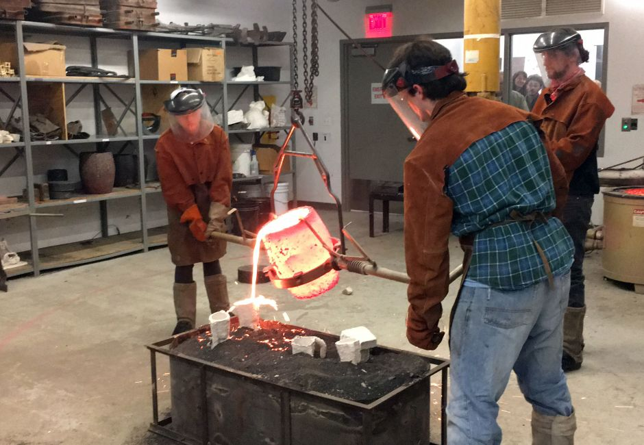 Live bronze pouring demonstration during Open Studio Night, Samuel M.V. Hamilton Building