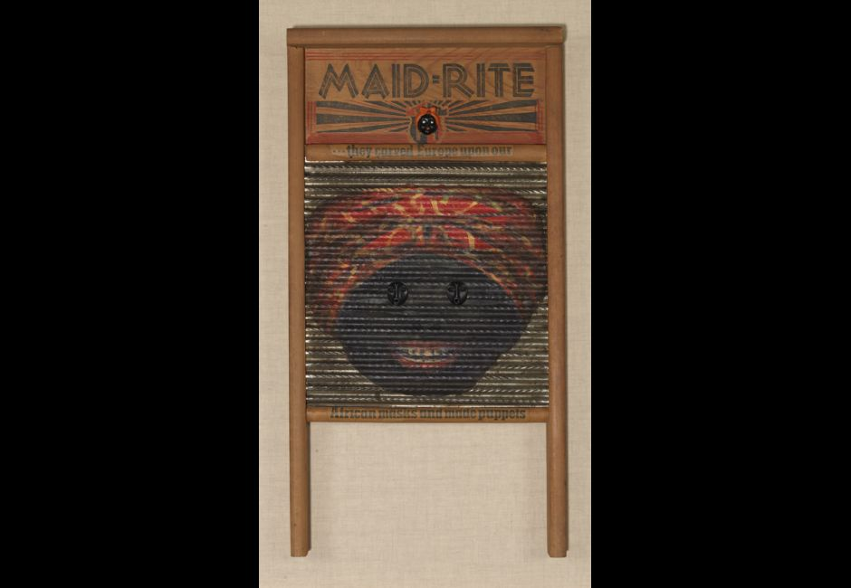 Betye Saar, Maid-Rite (Mask Eyes), 1998, Mixed media on vintage washboard, 24 x 12 x 2 in., Art by Women Collection, Gift of Linda Lee Alter, 2011.1.13