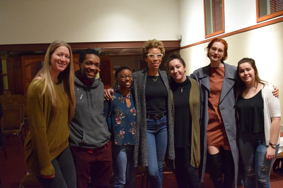 Amy Sherald (center) meets with students after the Visiting Artists Program lecture.