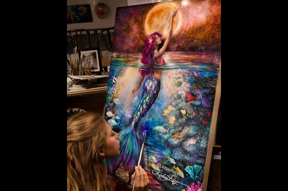 Lindsay Rapp (BFA '14) works on a painting.