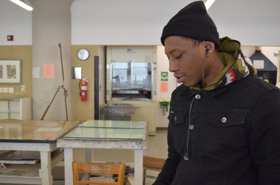 Aaron, a participant in the Restorative Justice Program, works in the print shop