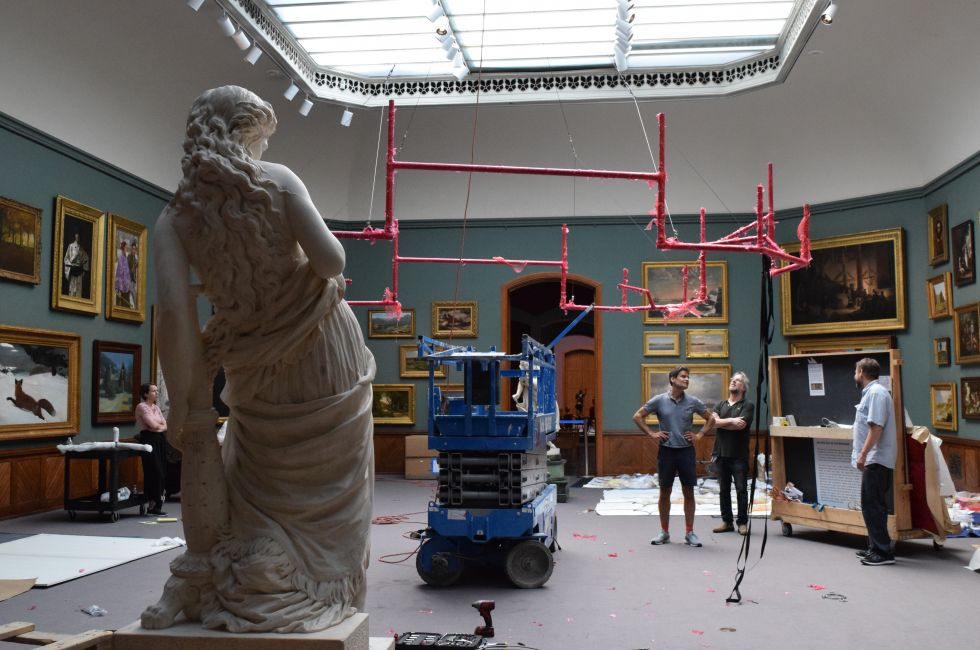 PAFA's installation team overseeing the construction of Banerjee's work.