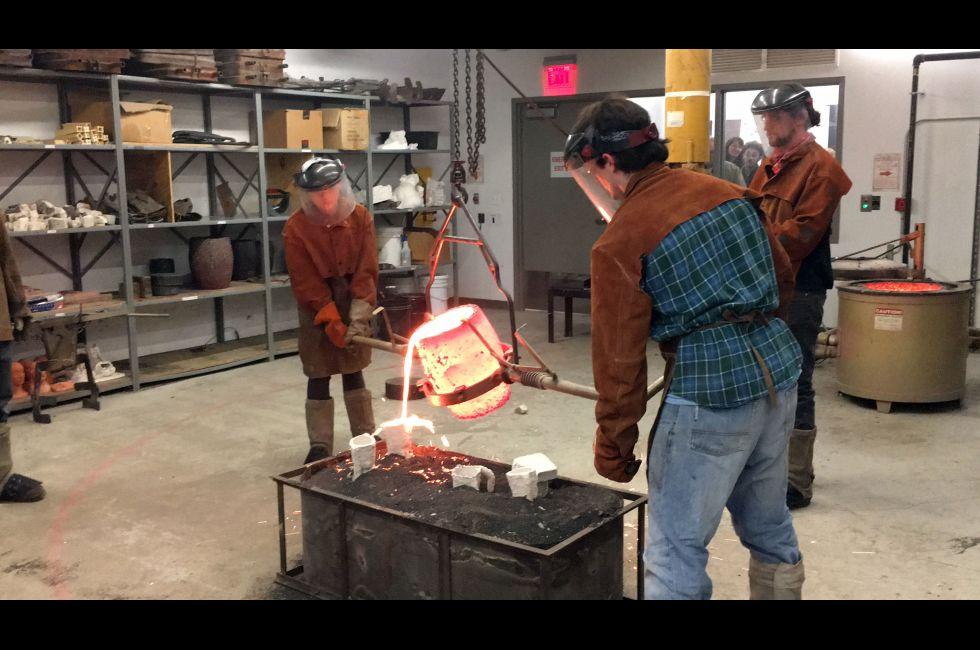 Live bronze pouring demonstration during Open Studio Night, Samuel M.V. Hamilton Building