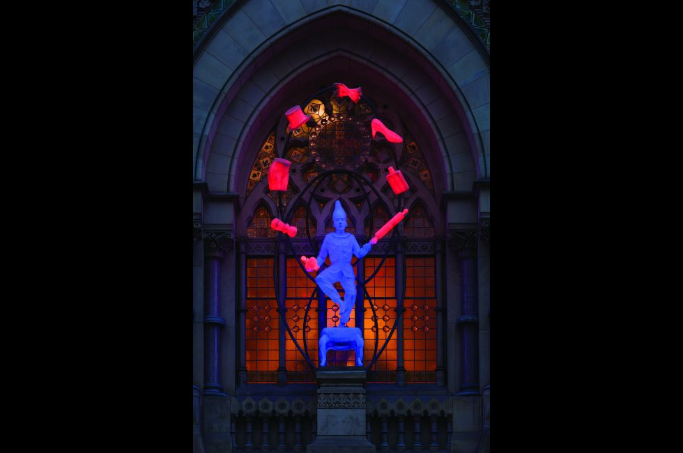 <em>The Young Punch Juggling</em>, by Robert Taplin, on the Historic Landmark Building plinth