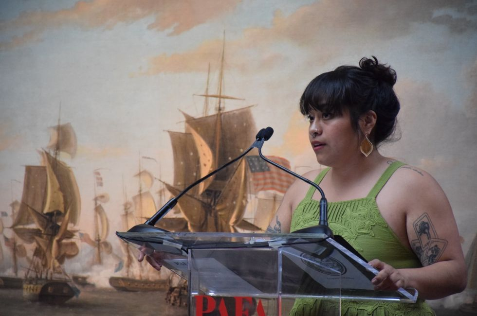 Jess Aquino '19 addresses graduating students and their families at PAFA's commencement exercises.