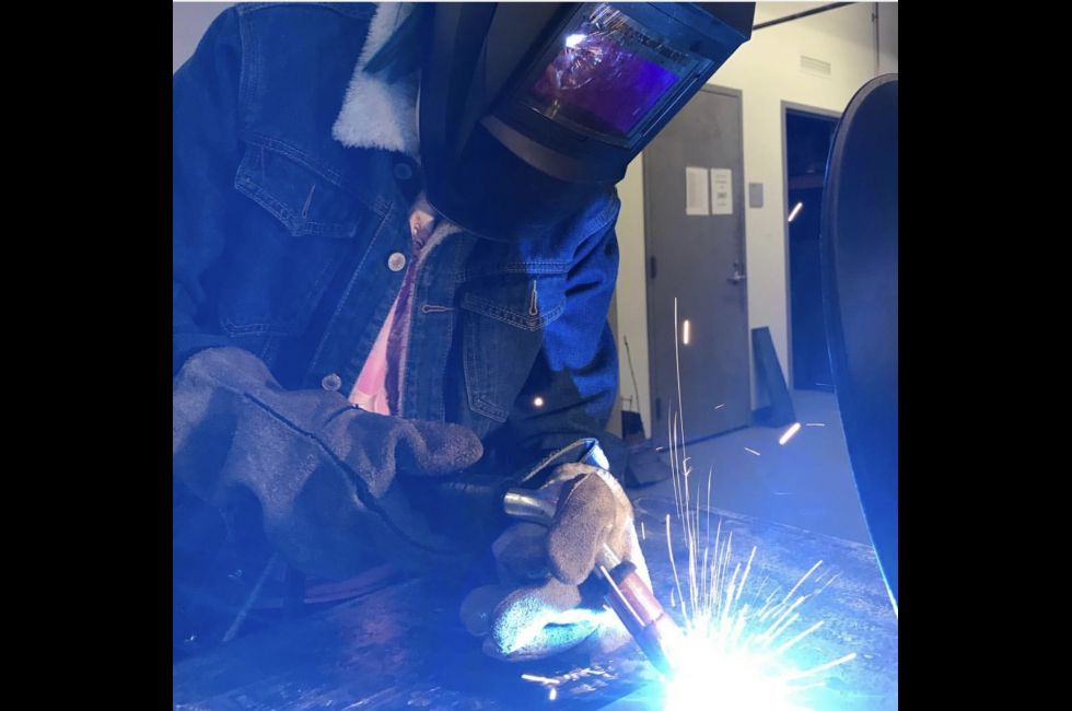 Luna Garisto (BFA '21) welding in the PAFA studios.