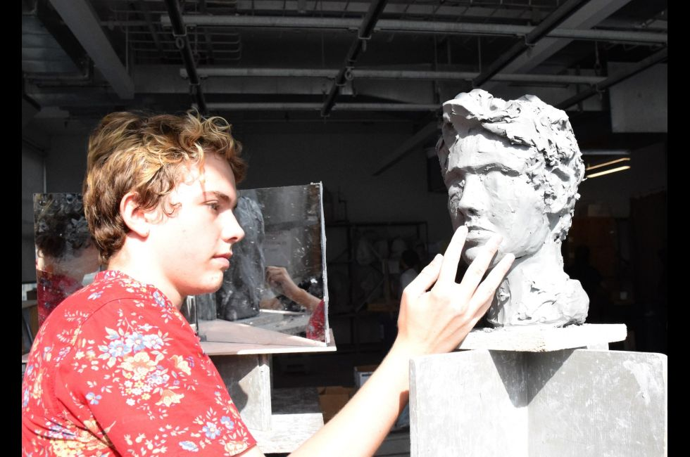 Summer Academy student Max Brenneman works on a sculpture during class.