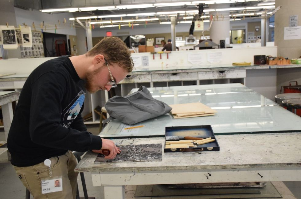 Nat Bombeke '22 at work in the Print Shop.