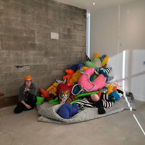 ashley garner poses with one of her soft sculptures