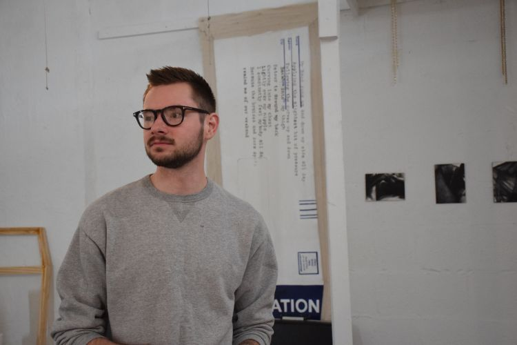 Andrew Snow (MFA '20) in his studio