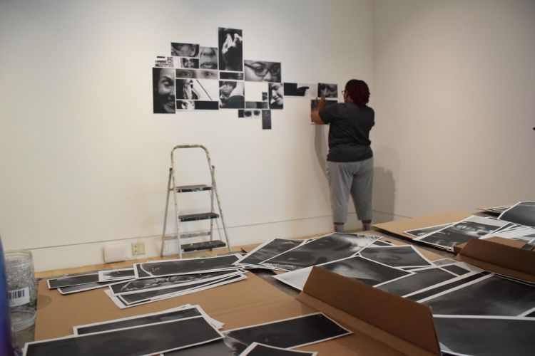 Lyn Townes (MFA '19) installs work in the School of Fine Arts gallery.