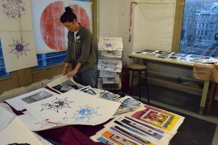 Students sell their prints at the Annual Print Sale.
