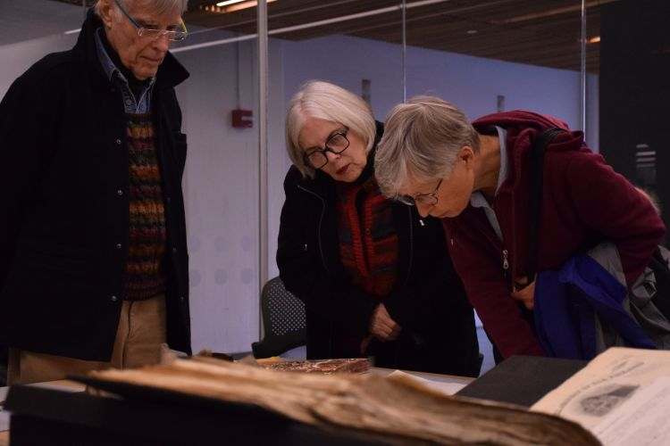 PAFA Members looking at prints from the collection