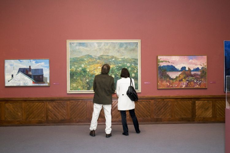 Members viewing paintings in HLB