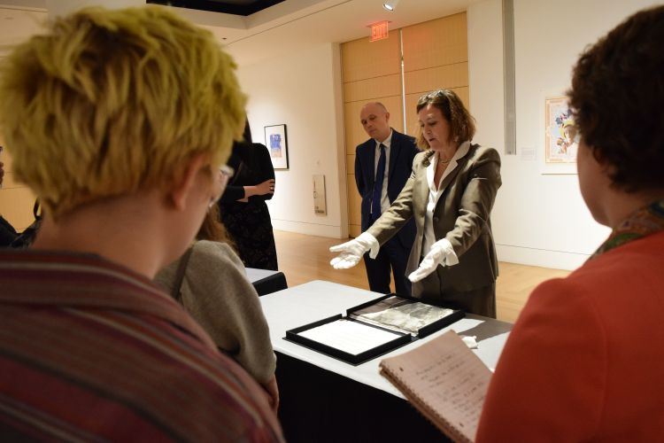 Brodsky Center Director Paola Morsiani guides visitors through a print portfolio