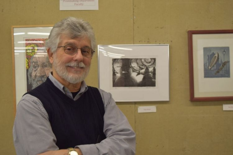 Instructor Toni Rosati with his prints